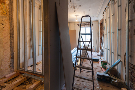Interior of upgrade apartment with materials during on the remodeling, renovation, extension, restoration, reconstruction and construction. ( making wall from gypsum plasterboard) Banque d'images