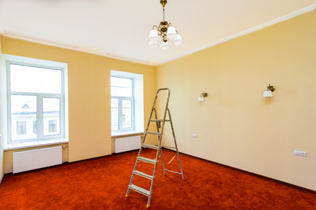 Interior of upgrade apartment with ladder after the remodeling, renovation, extension, restoration, reconstruction and construction(making wall from gypsum plasterboard,  wonder carpet or flooring roll) Stock Photo