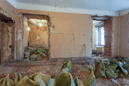 Dismantling of apartment's interior before upgrade  or  remodeling, renovation, extension, restoration, reconstruction and construction. ( sacks with construction waste and rubbish).