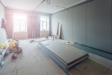 Working process of installing metal frames for plasterboard (drywall) for making gypsum walls  in apartment is under construction, remodeling, renovation, extension, restoration and reconstruction. Reklamní fotografie