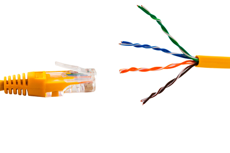 An ethernet wire cable and yellow patch-cord with twisted pair. Isolated