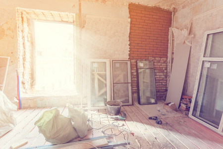 Working process of installing pvc windows in room of apartment is under construction, remodeling, renovation, extension, restoration and reconstruction Stock Photo