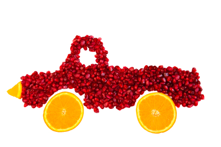 Seeds of pomegranate  is shape of lorry  isolated. Healthy food concept.