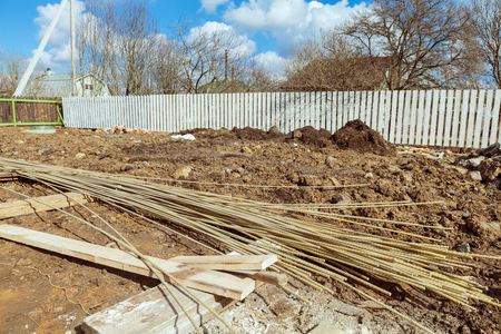 The building is under construction with new foundation after concrete pouring and making reinforcement metal framework and construction materials for that Banque d'images