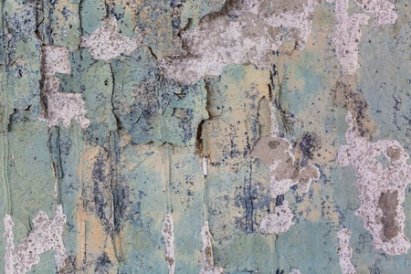 scratched painted cement wall with old color ragged plaster wall