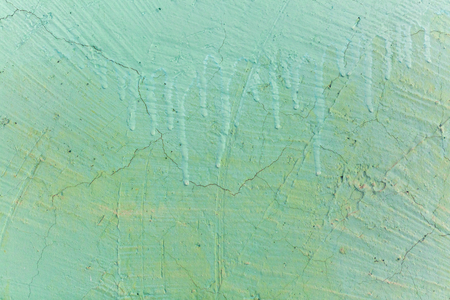 Scratched painted cement wall with old color ragged plaster wall texture. Background of old painted wall. Stock Photo
