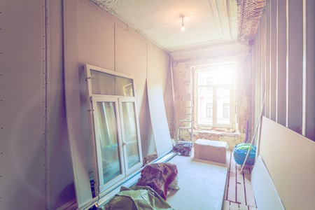 Working process of installing pvc windows and metal frames for plasterboard  -drywall - for making gypsum walls in room of apartment is under construction, remodeling, renovation, extension, restoration. overhaul and reconstruction.