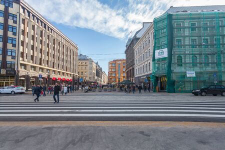 RIGA, LATVIA - MAY 06, 2017: View on wide pedestrian crossing or crosswalk with pedestrians that is located in the city center of Riga. Editorial