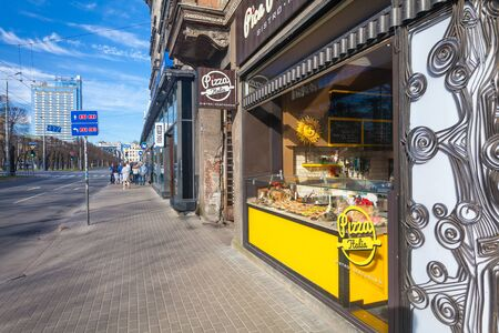 RIGA, LATVIA - MAY 06, 2017: View on the pizzeria or street food store  that is located in the city center of Riga. Editorial