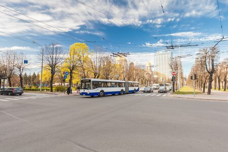 RIGA, LATVIA - MAY 06, 2017: View on crossroad  with public transport and cars  and  pedestrian crossing or crosswalk with pedestrians that is located in the city center of Riga.