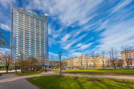 RIGA, LATVIA - MAY 06, 2017: View on the bulding of Radisson Blu Latvija Conference and Spa Hotel and part of centrally-located park Esplanade that is located in the city center of Riga.