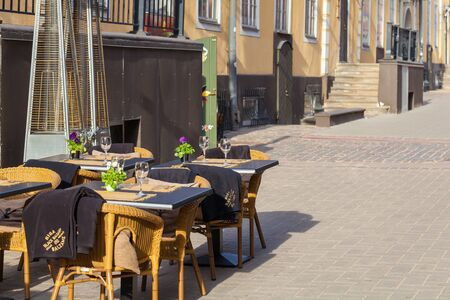RIGA, LATVIA - MAY 06, 2017: View on the empty tables of street cafe or restaurant is located in the city center of Riga.