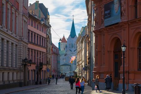 RIGA, LATVIA - MAY 06, 2017: View on the narrow cobbled street with old houses  are located in the city center of Riga.