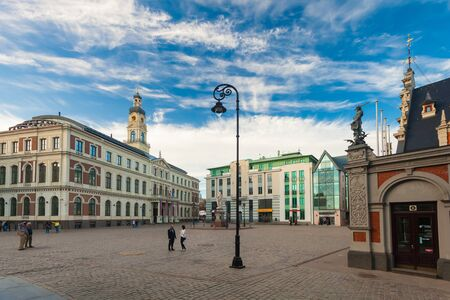 RIGA, LATVIA - MAY 06, 2017: View on the The Town Hall Square, Riga City Council - Riga Dome and Roland Statue are located in the city center of Riga.