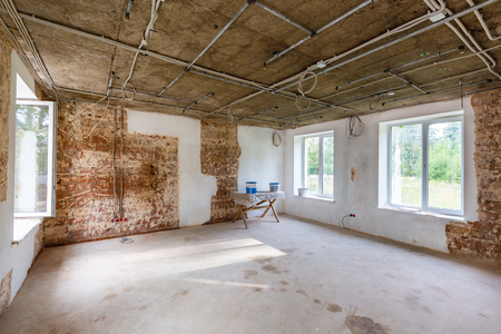 Working process of installing metal frames for plasterboard -drywall - for making gypsum walls  in apartment is under construction, remodeling, renovation, extension, restoration and reconstruction. Reklamní fotografie