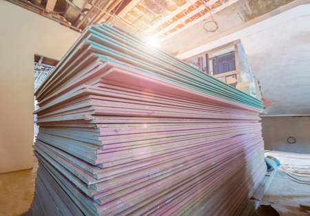 Working process of installing metal frames for plasterboard drywall for making gypsum walls in apartment is under construction, remodeling, renovation, extension, restoration and reconstruction.