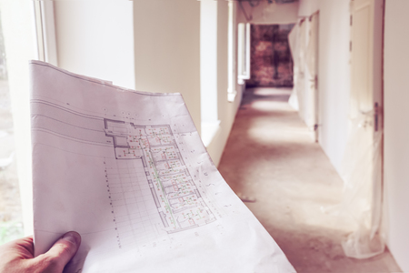 Architectural  plan with details, marked by measurements, construction and design details in engineer hand and corridor with windows, doors,  in an apartment during on the construction,overhaul,  remodeling, rebuilding, home improvements  and renovation. Imagens