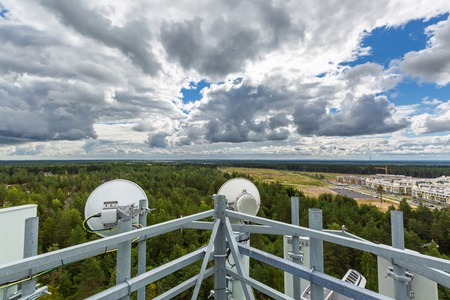 Telecommunication tower with microwave, radio antennas, remote radio units, power and optic cables