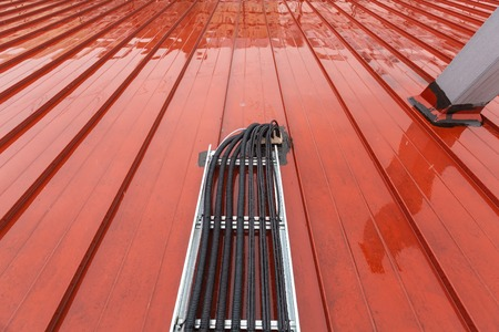 Cable tray outside with telecommunications cables, optic fiber, power cables and transmitter data cables from antennas and outdoor remote radio units to inside equipment of telecommunication basic stations and sealing solutions to prevent water,  rainfall,  dust and moisture from roof to inside