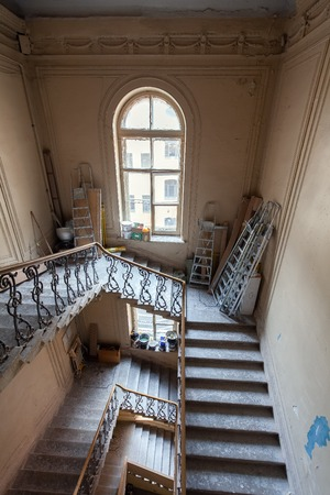 Construction materials and ladders are on the stairs of apartment is under construction, remodeling, renovation, extension, restoration and reconstruction. Concept of total home improvement or renovate.