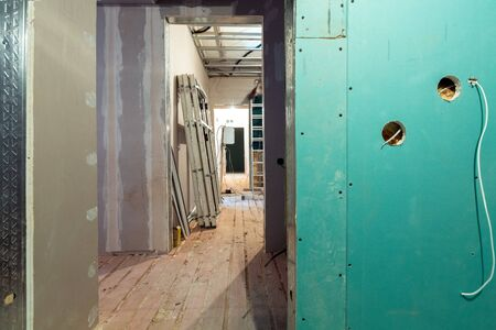 Working process of installing  frames for plasterboard - drywall and construction tools in apartment is under construction, remodeling, renovation, extension, restoration and reconstruction. 写真素材