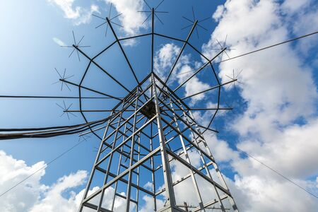 Antennas of military radio station are on the roof and blue sky as a background. Stock fotó