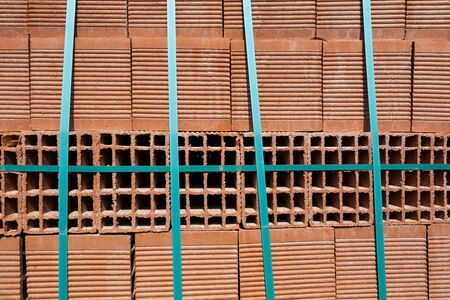 Construction Materials. Building materials for construction of residential complex. Pile of red bricks at construction site. 写真素材