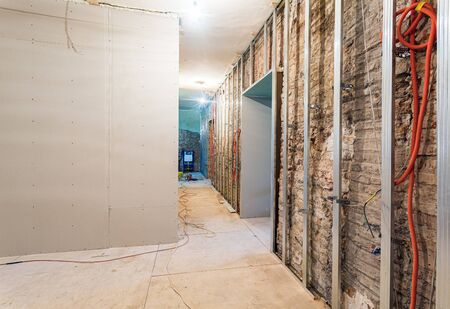 Frames for plasterboard for making gypsum walls on the brick wall in an apartment is under construction, remodeling, renovation, restoration, reconstruction