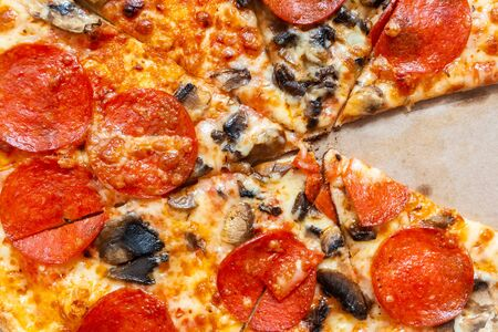 Slices Pizza pepperoni with tomatoes and mushrooms