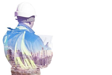 Collage of silhouette construction worker in helmet and uniform reads technical documentation and construction site. Effect of double exposure 스톡 콘텐츠