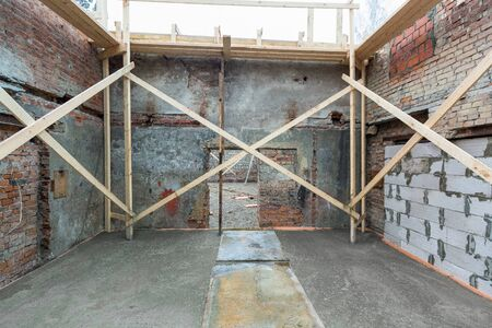 Strengthening walls inside building with cement filling floor in apartment is under construction, remodeling, renovation and reconstruction. Concept of home improvement or renovate.