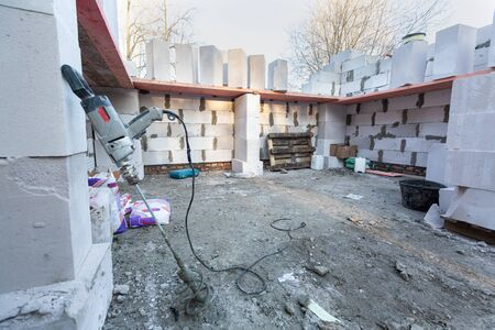 Unfinished wall made from foamed concrete block during the building house on the construction site 스톡 콘텐츠 - 149214027