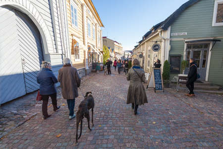 Finland, Porvoo - October10, 2016: OLd street and tourists in old town Porvoo.