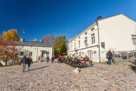 Finland, Porvoo - October10, 2016: OLd square and tourists in old town Porvoo.