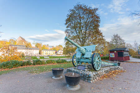 Porvoo, Finland, October 08, 2016: Military monument - cannon in the cargo station in old town Porvoo. 에디토리얼