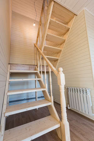 The wood stairs of new house after construction and renovation. Concept of Housewarming and new dwelling.