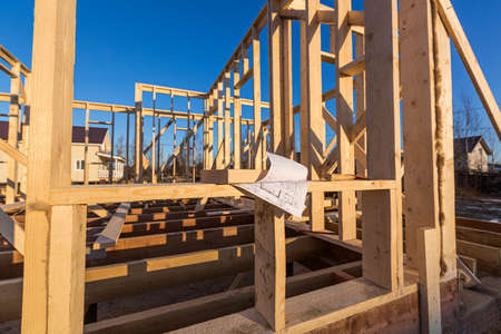 New residential construction of wooden frame house. Roofing construction. Wooden construction. Construction site.