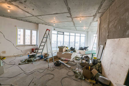 Working process of installing metal frames for plasterboard -drywall - for making gypsum walls in apartment is under construction, remodeling, renovation, extension, restoration and reconstruction. 스톡 콘텐츠