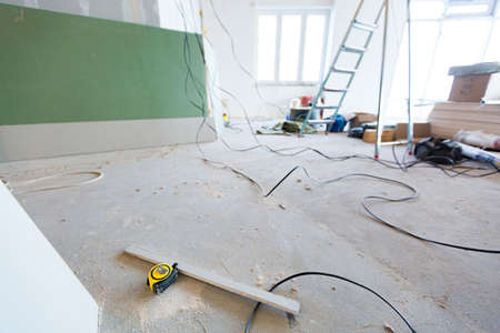 Working process of renovate room with installing drywall or gypsum plasterboard in apartment is under construction, remodeling, renovation, extension, restoration and reconstruction. Concept of home improvement or renovate. 스톡 콘텐츠