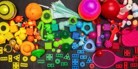 Many colorful toys collection on the black background.