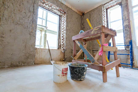 Working process of renovate room from wooden platform in apartment is under construction, remodeling, renovation, extension, restoration and reconstruction.