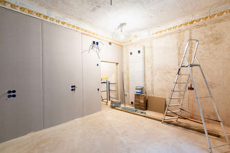 Working process of installing gypsum walls from plasterboard -drywall - in apartment is under construction, remodeling, renovation, extension, restoration and reconstruction.