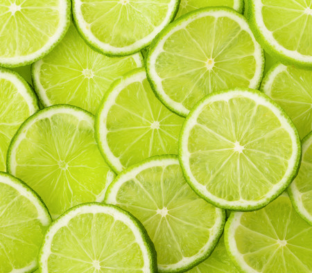 Green background with citrus-fruit of lime slices 版權商用圖片 - 29884892