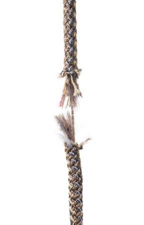 eminent: Piece of rope frayed about to break on white background