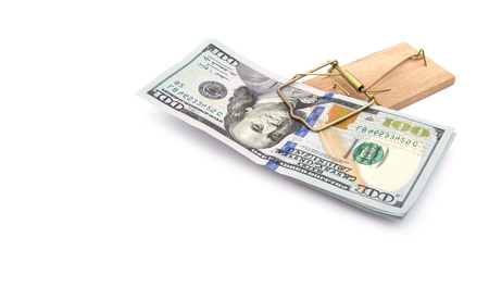 mousetrap: Money in a mousetrap on a white background