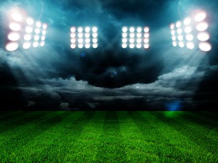hockey sobre cesped: las luces del estadio en la noche y el estadio