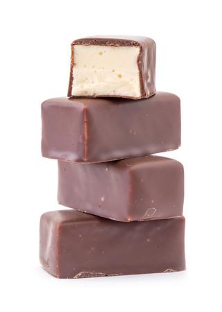 Delicious chocolates on a white background. photo