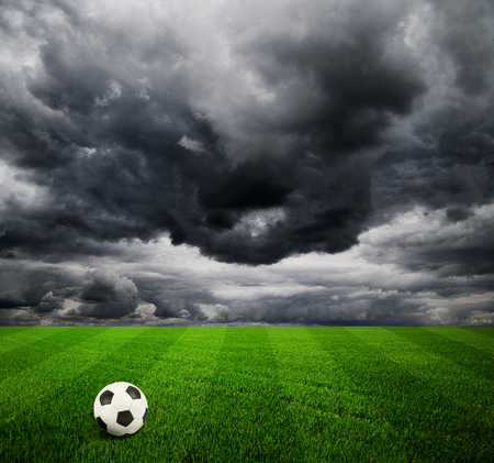 winning pitch: Soccer ball on the field of stadium with light Stock Photo