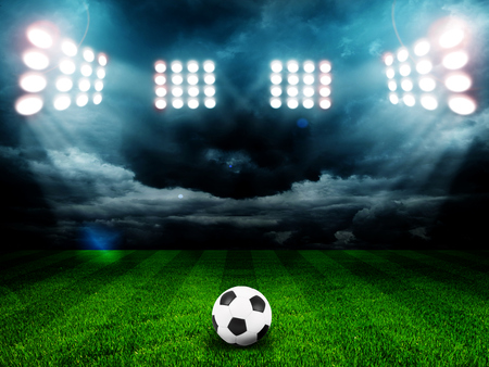 green field: Soccer ball on the field of stadium with light Stock Photo