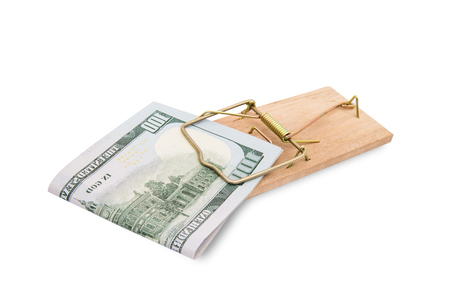 mouse trap: Money in a mousetrap on a white background